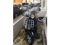 Beautiful Vespa Piaggio 2013. Very well conserved, dark blue, brown seat, elegant and rarely used