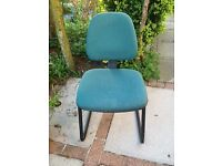 A comfortable chair which is upholstered in Green mottled fabric.