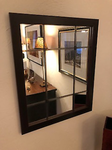 Mirror with steel inserts