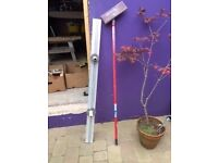 Plastering Darby and sanding pole