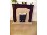 Wooden fire surround, marble hearth and back, valor balanced flue gas fire if wanted.