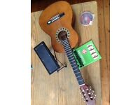 Child's guitar, case, chord book, cd, foot rest and tuning pipe