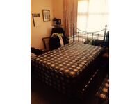 Small double size bed (comfy spring mattress and metal rail headboard included)