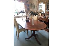 Beautiful solid wood Oval Extending dining table.