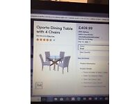Brand new, still boxed, Oporto glass circular table and 4 chairs