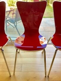 4 red acrylic 'Grazia' dining chairs