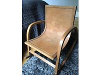 Vintage child's wooden rocking chair with dutch motif