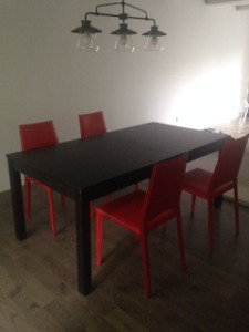 Table Ikea de la collection BJURSTA noir-marron avec rallonges