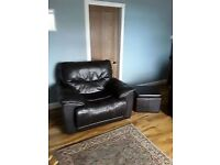 Dark brown leather manual recliner sofa and electric recliner armchair with storage footstool