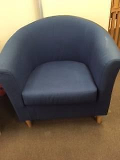 Two blue single tub armchairs, each with matching cushion