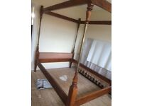 Four Post Double Bed, strong wooden frame c/w wooden slats & brass spindles