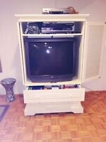 Solid wood unit with  32 in JVC. TV included   Like new