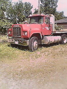 1984 Mack with Tilting Deck.