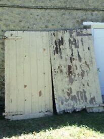 A pair of very old barn or garage wooden doors