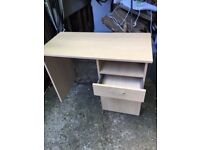 As new. Light oak laminate desk. Would suit office/study. 1 drawer + 1 cupboard. v. g. condition.