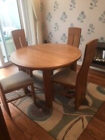 Solid oak extendable table with 4 chairs.