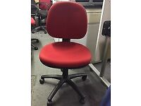 Red upholstered swivel chair