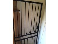Solid metal security gate/grill 195cm x 93cm, good condition with lock and keys