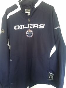 Oilers outer wear and Nike track pants