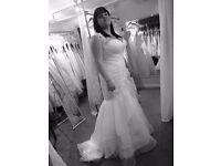 Size 16 strapless ivory fishtail wedding dress. Brand new. Never been worn