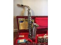 G. H. Huller antique saxophone and Besson clarinet
