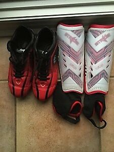 Kids soccer shoes and shin pads size 5