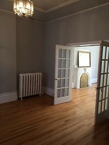 Available June 1st, uptown 2 bedroom main level