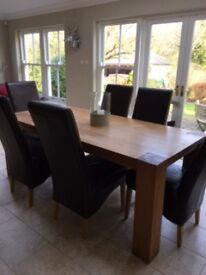 Barker and Stonehouse large oak table and 6/8 brown leather chairs.