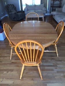 Wooden kitchen table with 4 chairs.