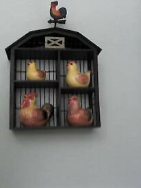 porcelain chickens in a wall frame