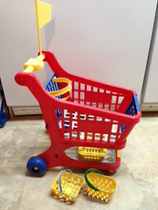 kids shopping cart with lots of food pieces $10.00