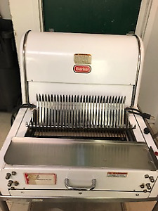 Berkel Bread Slicer: Heavy Duty, In good used condition.