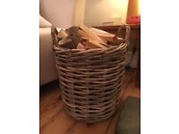 Wicker log basket (including logs). Excellent condition. Available now for collection. £20.