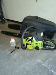 POULAN 38 cc CHAIN SAW WITH CASE & OIL.   ( used twice )