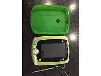 Green Leap Frog Leap Pad 2 Explorer With Stylus and Gel Cover with Children's JVC headphones.