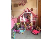 Barbie Malibu Dream House with accessories, dolls, car and pool.