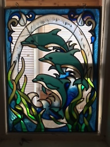 Dolphins in stain glass to be hung