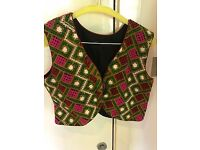 Female colourful vest