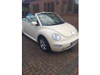 Cream Volkswagen Beetle convertible for sale