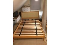 King size quality light wood bed frame and headboard with slatted bed base.