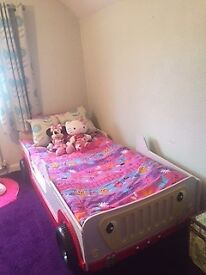 Childs single car bed in good condition.