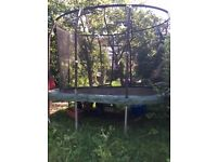 Now sold! Large outdoor trampoline with safety net for sale 10' by 6'. £30