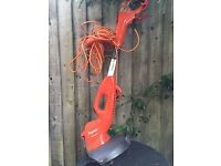 Flymo strimmer with telescopic handle
