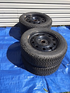 4 Firestone Winterforce Tires and Rims Mounted