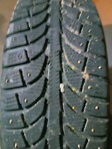 Four 205/55/R16 Studded Tires On Toyota Rims