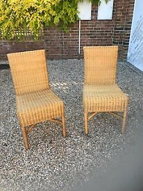 Two wicker dining/ kitchen chairs