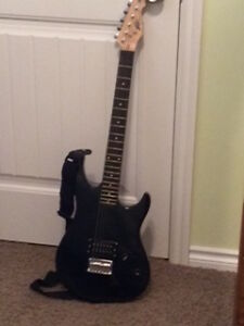 Electric Peavey Rockmaster Guitar + Amp + accessories