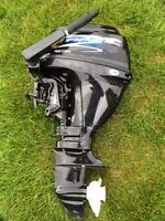 Must Sell! 15 Hp outboard and 11 ft inflatable.