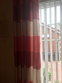 RED STRIPED CURTAINS WITH CREAM TIEBACKS