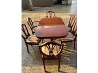 lovely table with 6 chairs,needs sold asap
